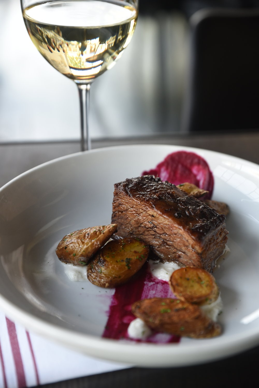 Braised Beef Short Rib - Herb roasted fingerling potatoes, red cabbage puree & horseradish cream.