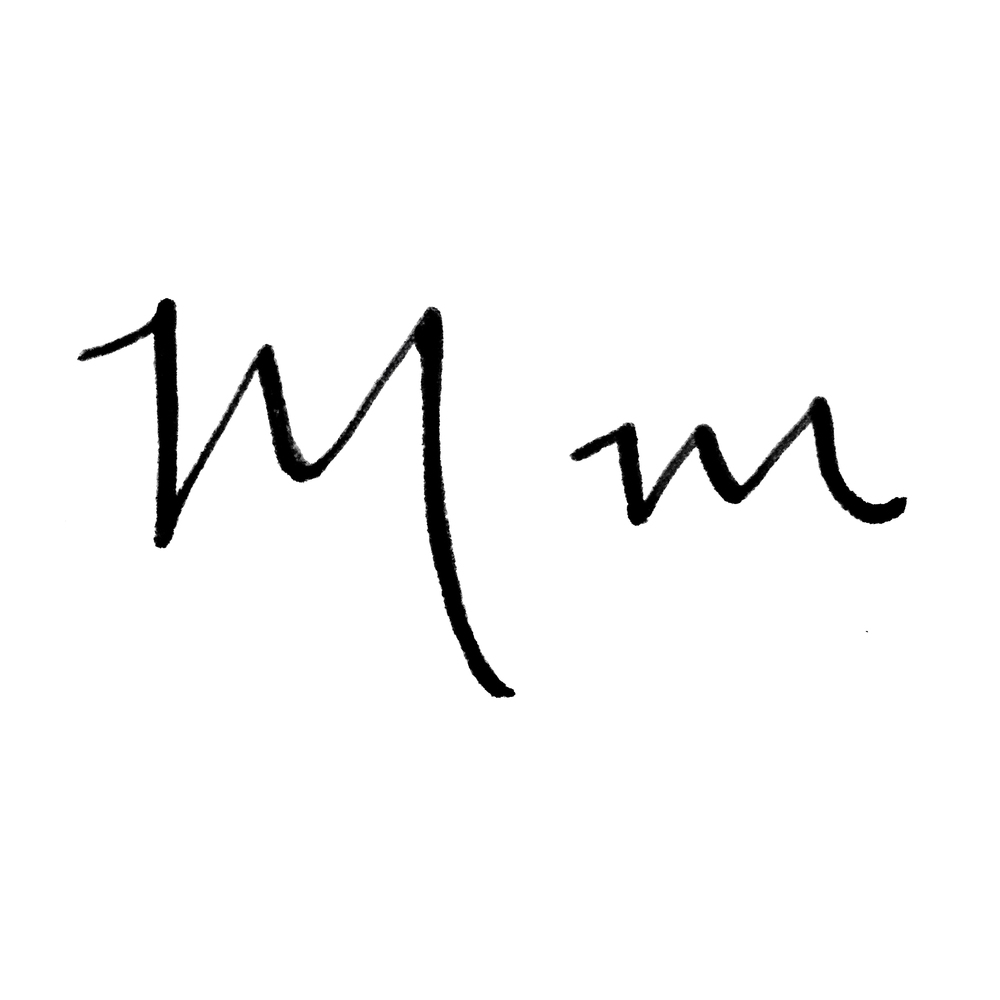 Hand lettered M's with thickened downstrokes give the appearance of being written in calligraphy.