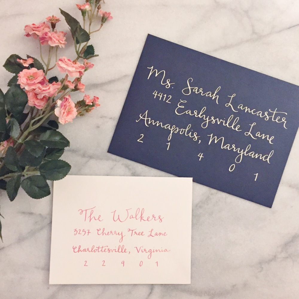 Watercolor Calligraphy on a Navy Envelope for The Rising Tide Society Styled Shoot