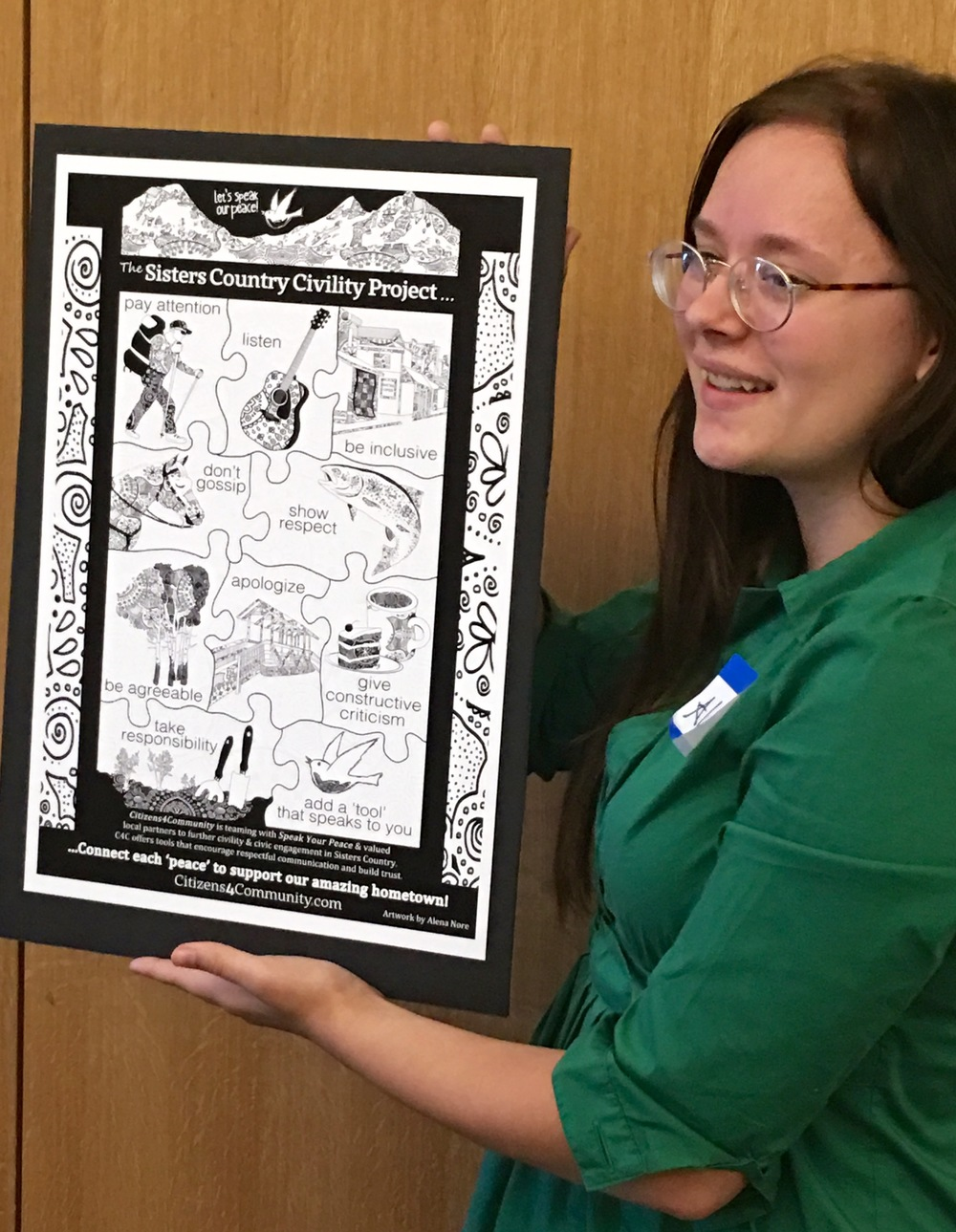 Alena Nore presents her Sisters Country Civility Project poster artwork on July 12 at the Sisters Fire Hall during C4C's quarterly information and learning session.