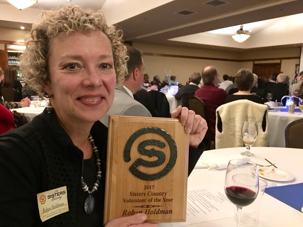 Robyn shows off her award plaque during the February 8, 2018 awards ceremony.