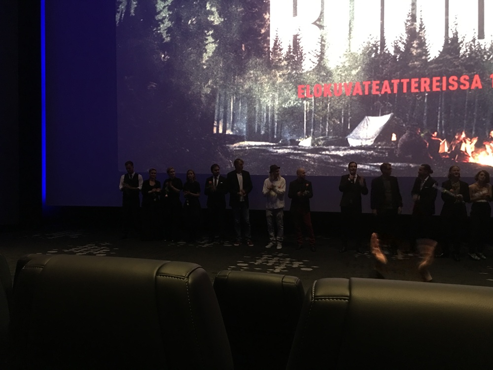 Producer  Aleksi Hyvärinen  speaking at the premiere, with director  Taneli Mustonen  third from right