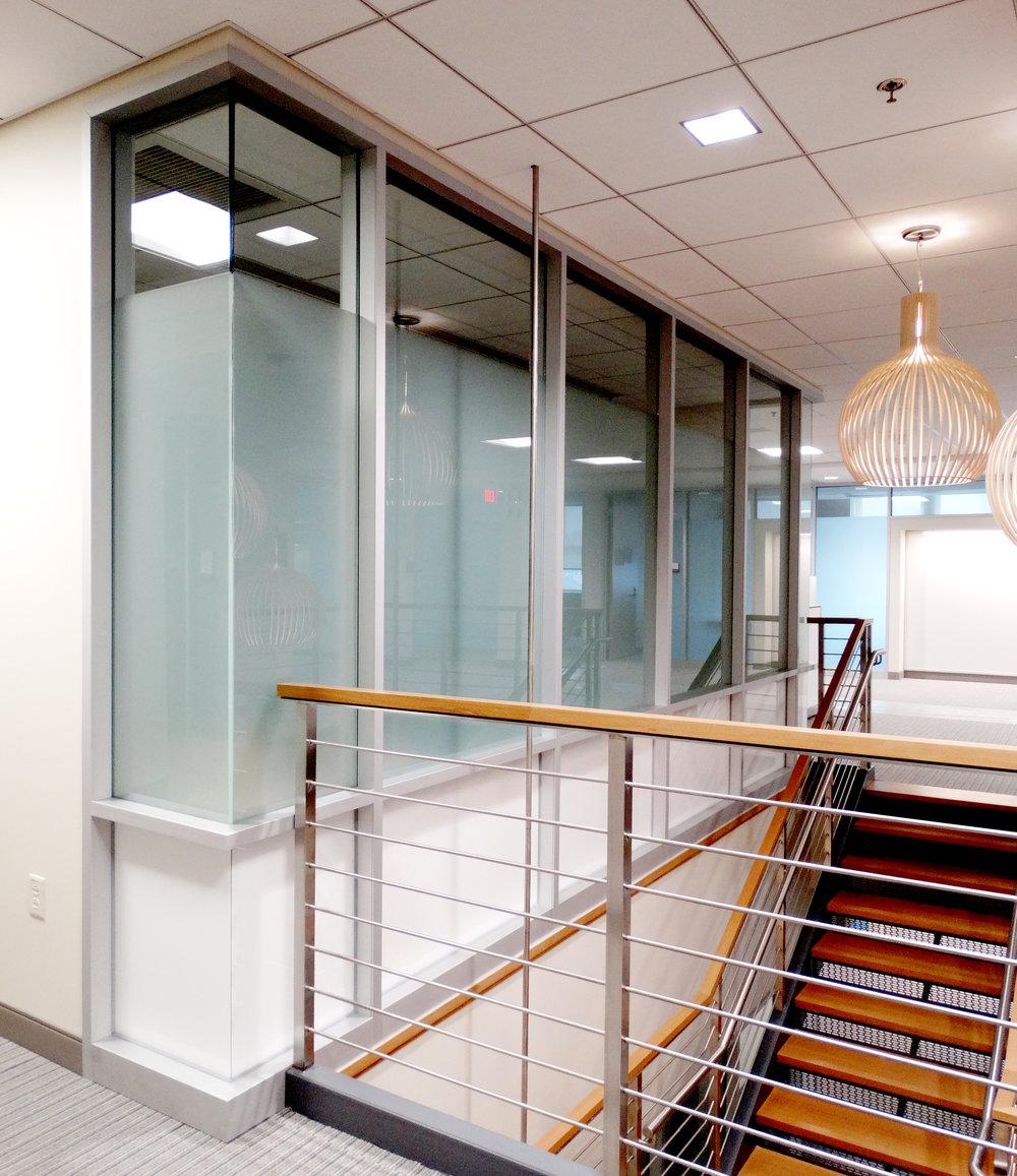 Encase Aluminum Framed White Glass Wall System - Spaceworks AI.jpg