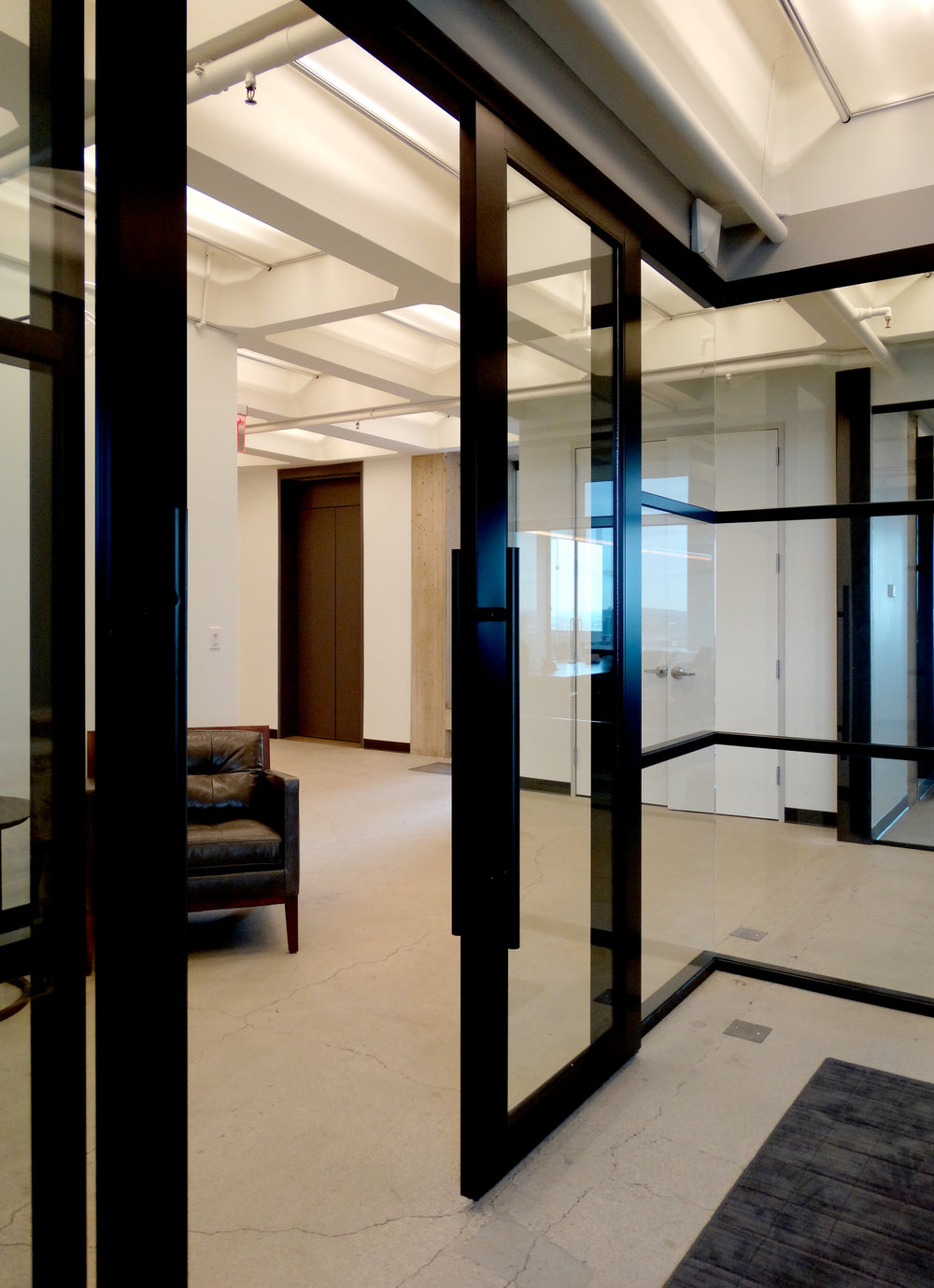 Encase Black Aluminum Framed Glass Doors Black Ladder Pulls - Spaceworks AI.JPG