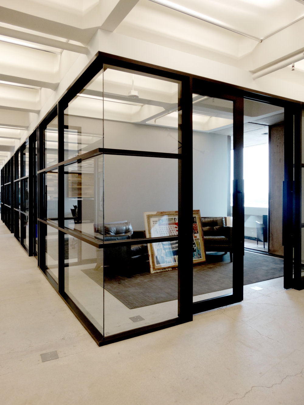Encase Black Powder Coated Aluminum Framed Glass Wall System - Spaceworks AI.JPG
