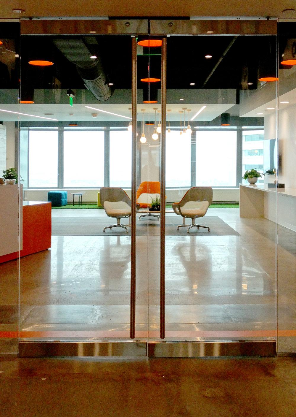 Illume Elevator Lobby Frameless Doors - Spaceworks AI.jpg