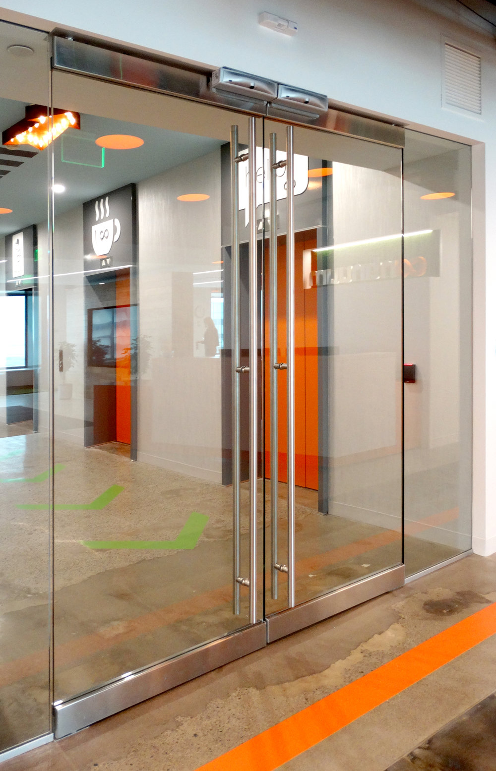 Illume Elevator Lobby Frameless Entry Double Door - Spaceworks AI.jpg