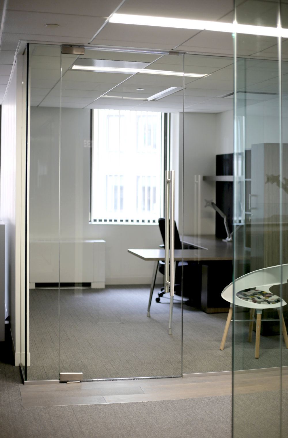 Illume Frameless Glass Office Door - Spaceworks AI.jpg
