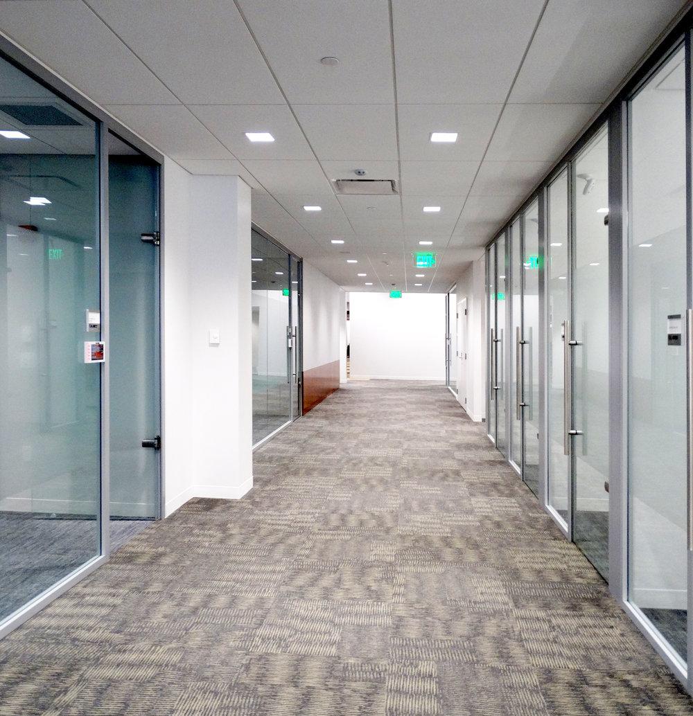 Litespace Frameless Glass Sliding Door Office Hallway - Spaceworks AI.jpg