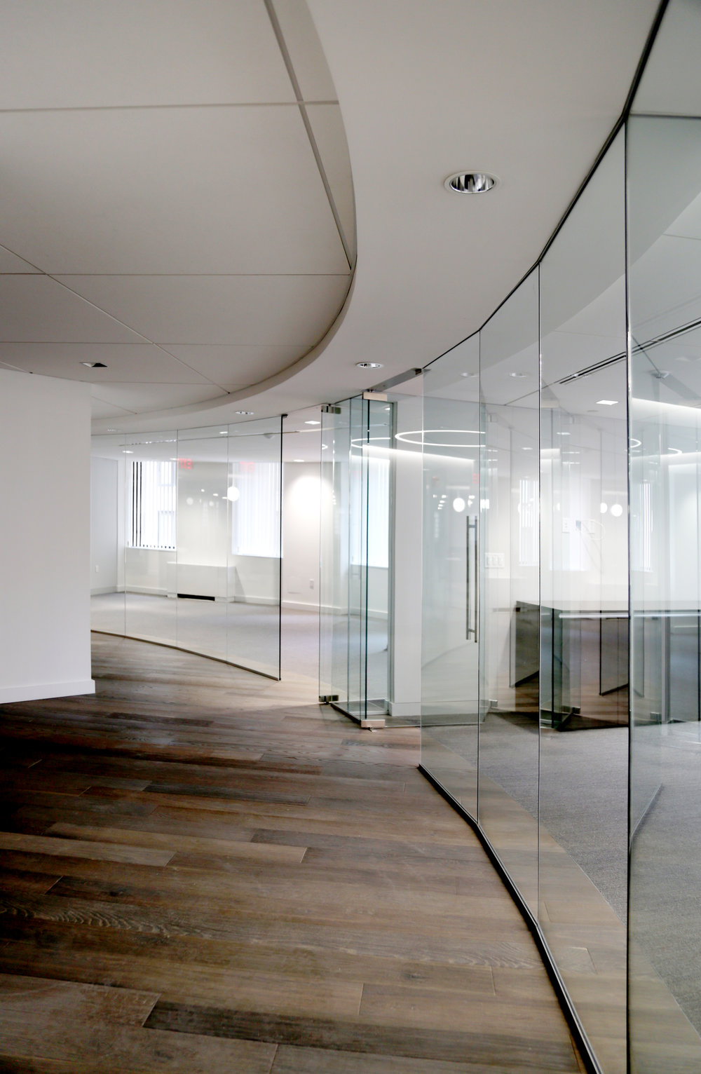 Illume Frameless Glass Curved Wall - Spaceworks AI.jpg