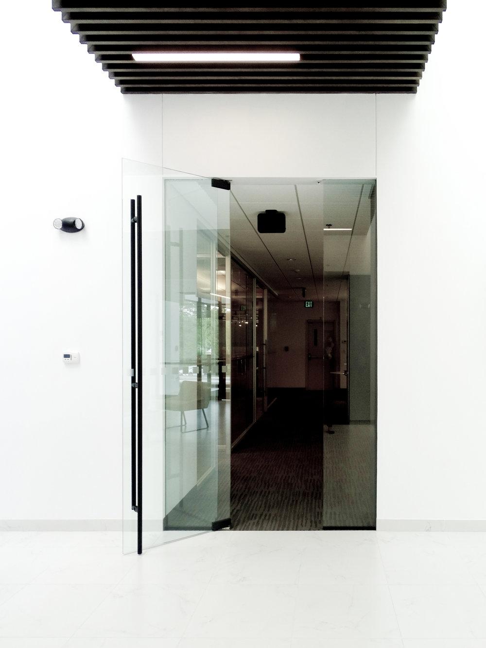 Illume Frameless Door ADA Ladder Pull - Spaceworks AI.JPG