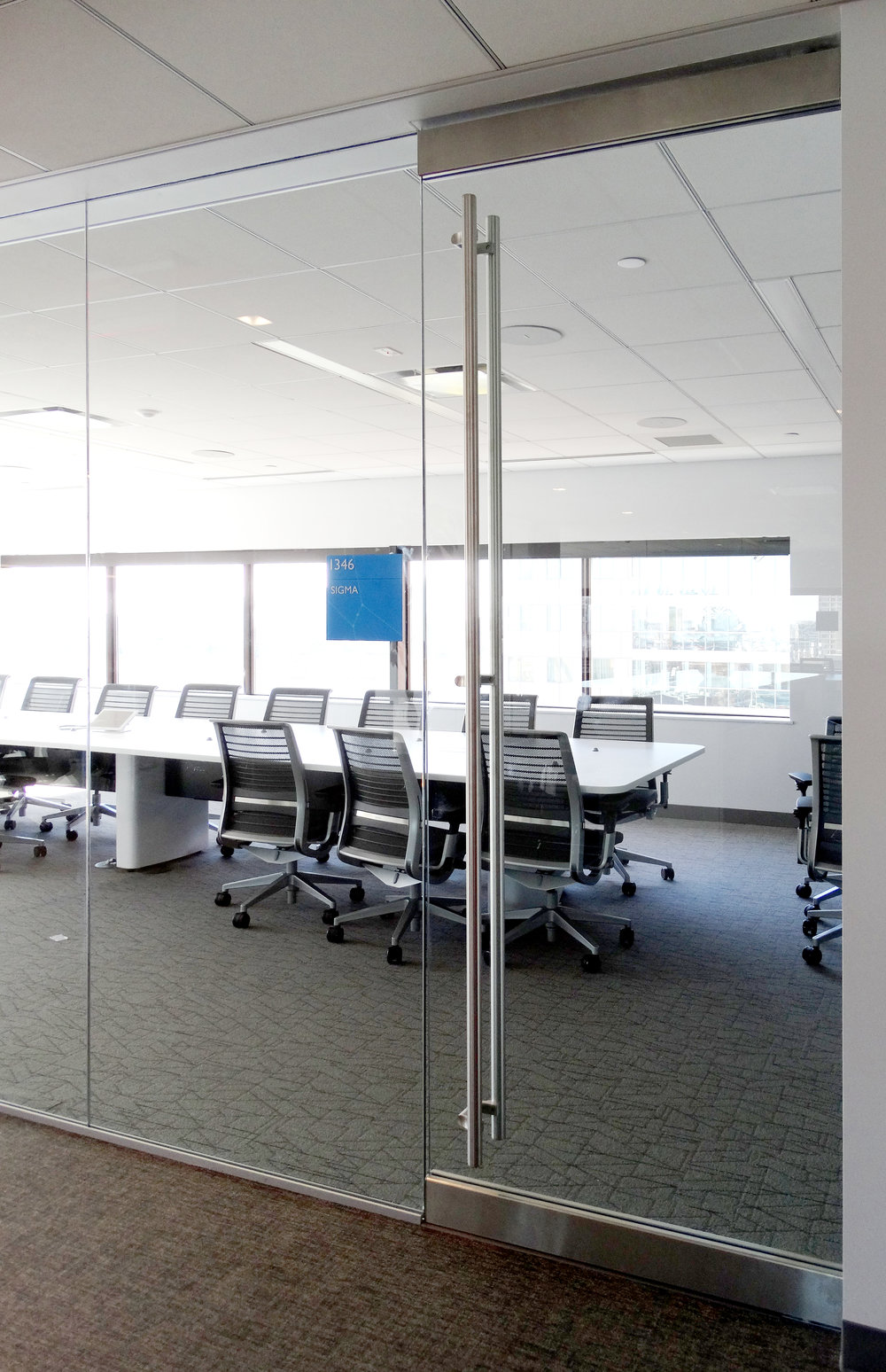 Illume Frameless Glass Conference Rail Door - Spaceworks AI.jpg