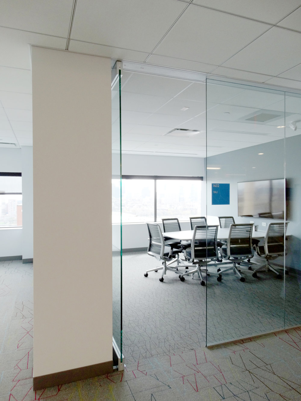 Illume Frameless Glass Conference Room Door - Spaceworks AI.jpg