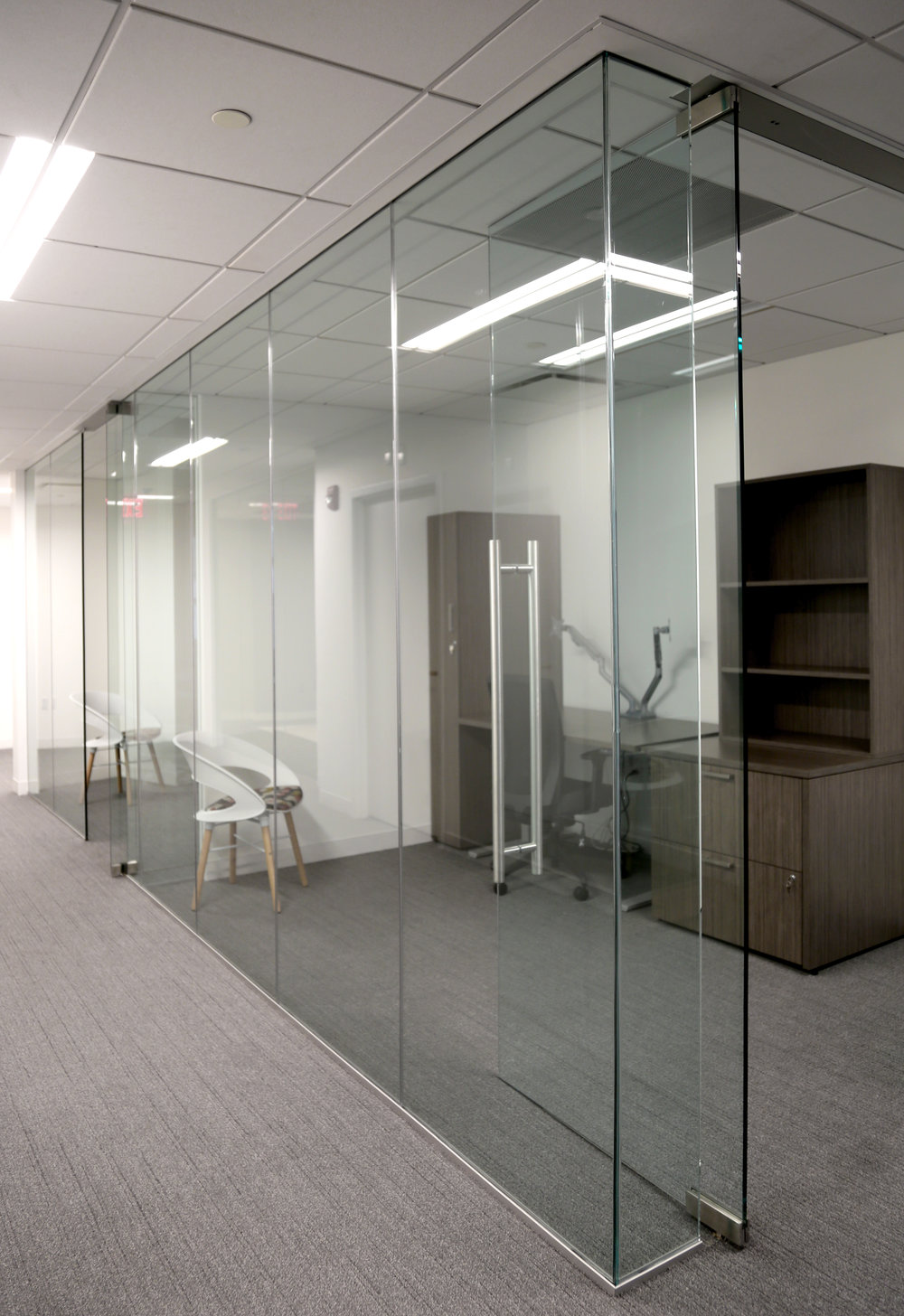 Illume Frameless Glass Office Run - Spaceworks AI.jpg