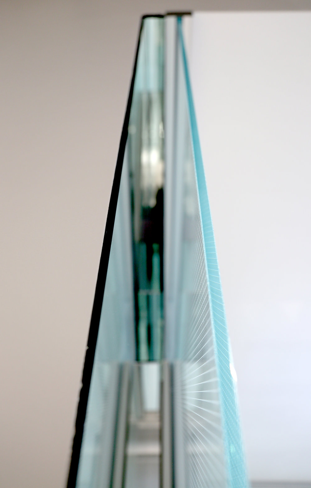 Litespace Specialty Glass Mirror Layered Wall Detail - Spaceworks AI.jpg
