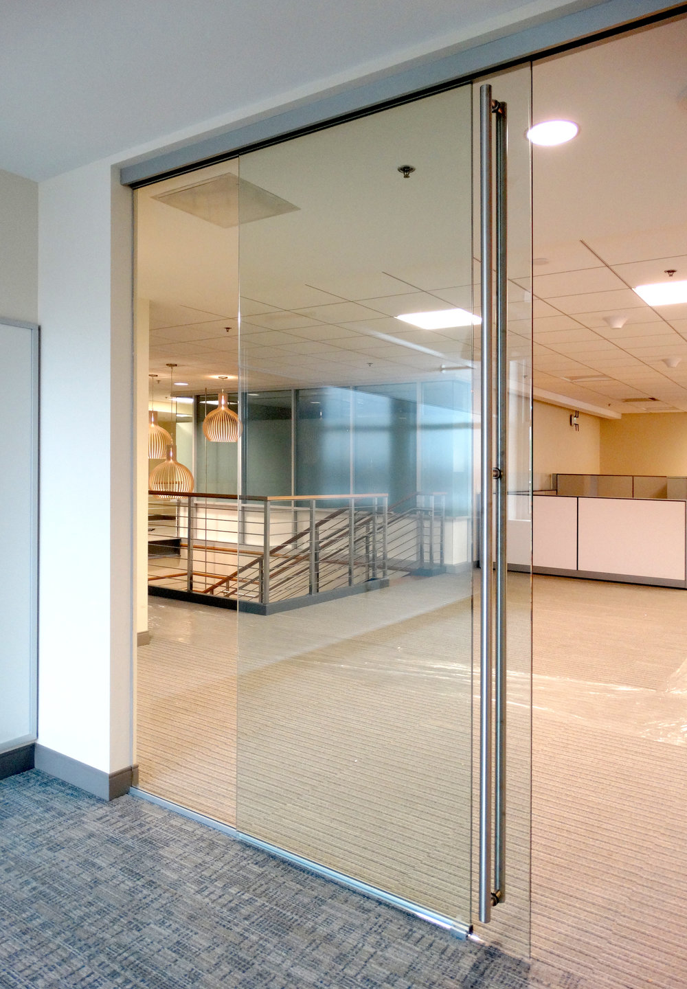 Encase Frameless Glass Sliding Door Office Wall - Spaceworks AI.jpg