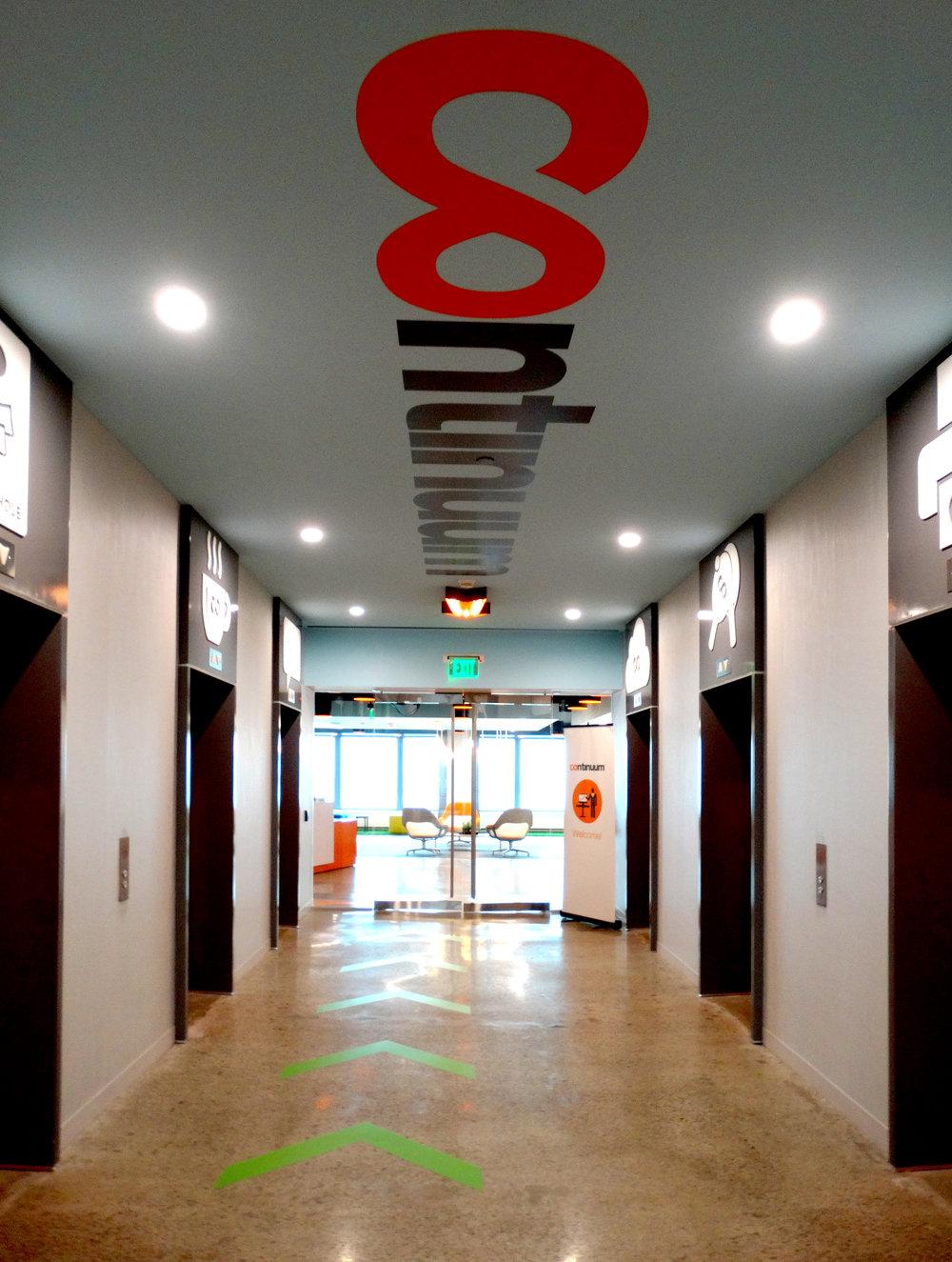 Illume Elevator Lobby Frameless Entry Doors - Spaceworks AI.jpg