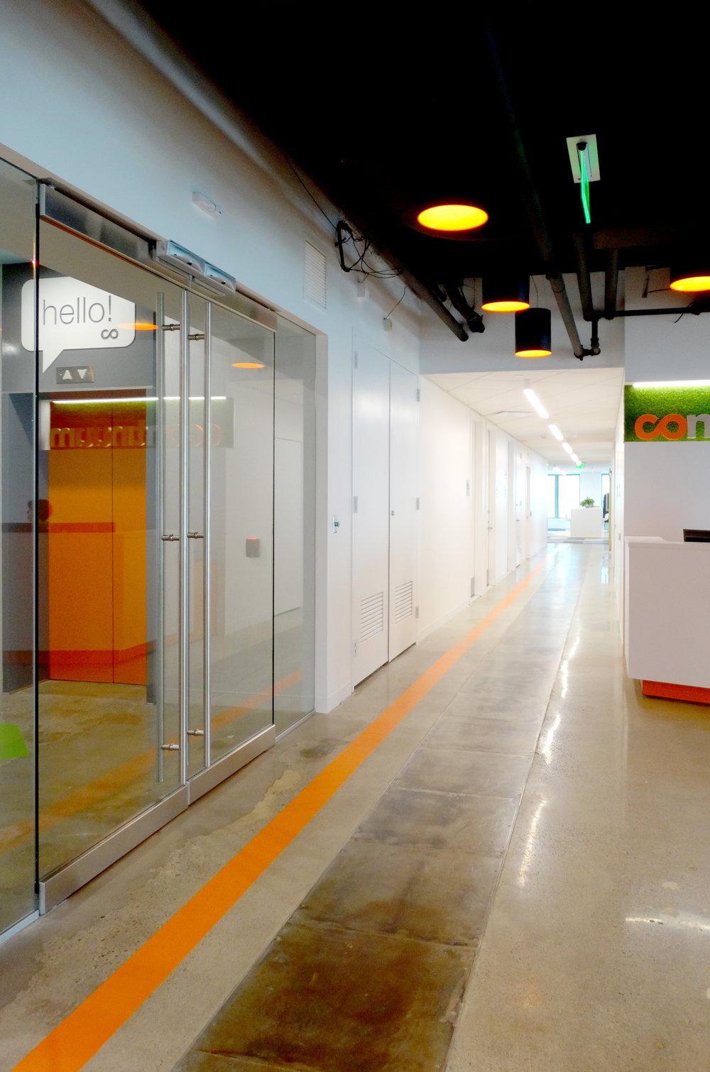 Illume Elevator Lobby Frameless Glass Assembly - Spaceworks AI.jpg