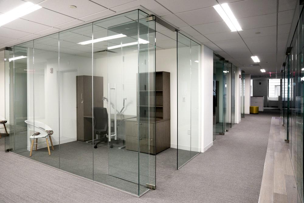 Illume Frameless Glass Office Corner Turn - Spaceworks AI.jpg