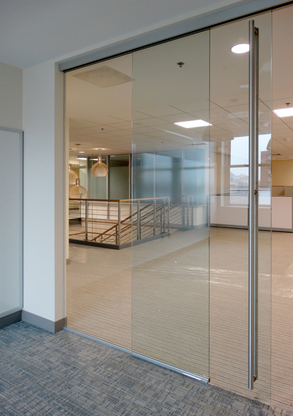 Illume Frameless Glass Sliding Door Full Height Ladder Pull - Spaceworks AI.jpg