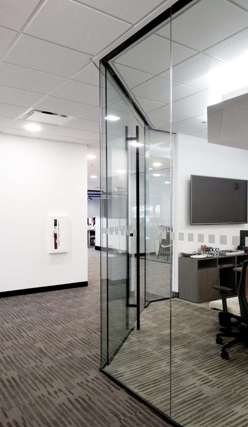 Illume Frameless Glass Sliding Door Office Wall - Spaceworks AI.JPG