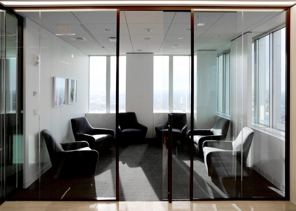 Modernus Dark Anodized Aluminum Framing System Frameless Glass Sliding Door - Spaceworks AI.jpg