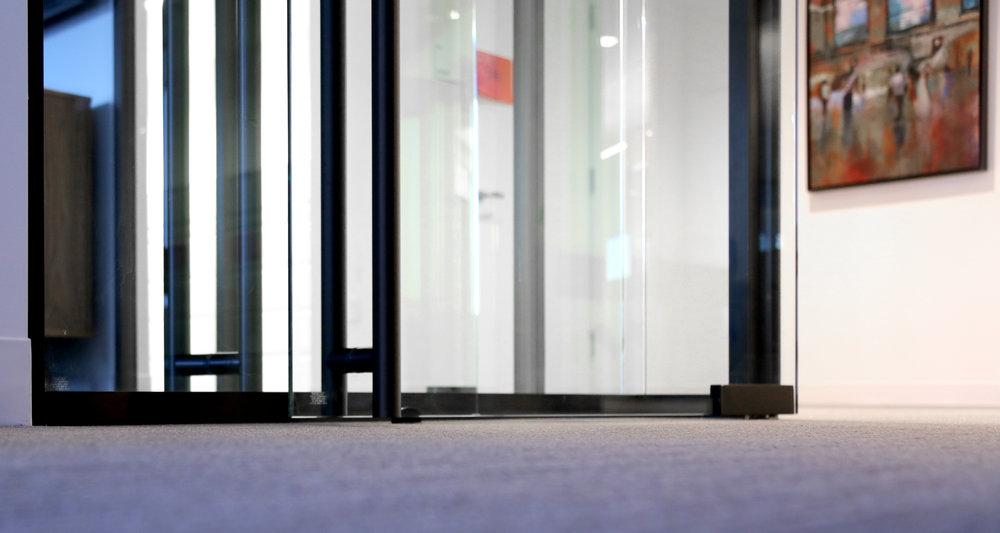 Modernus Frameless Glass Pivot Doors - Spaceworks AI.jpg