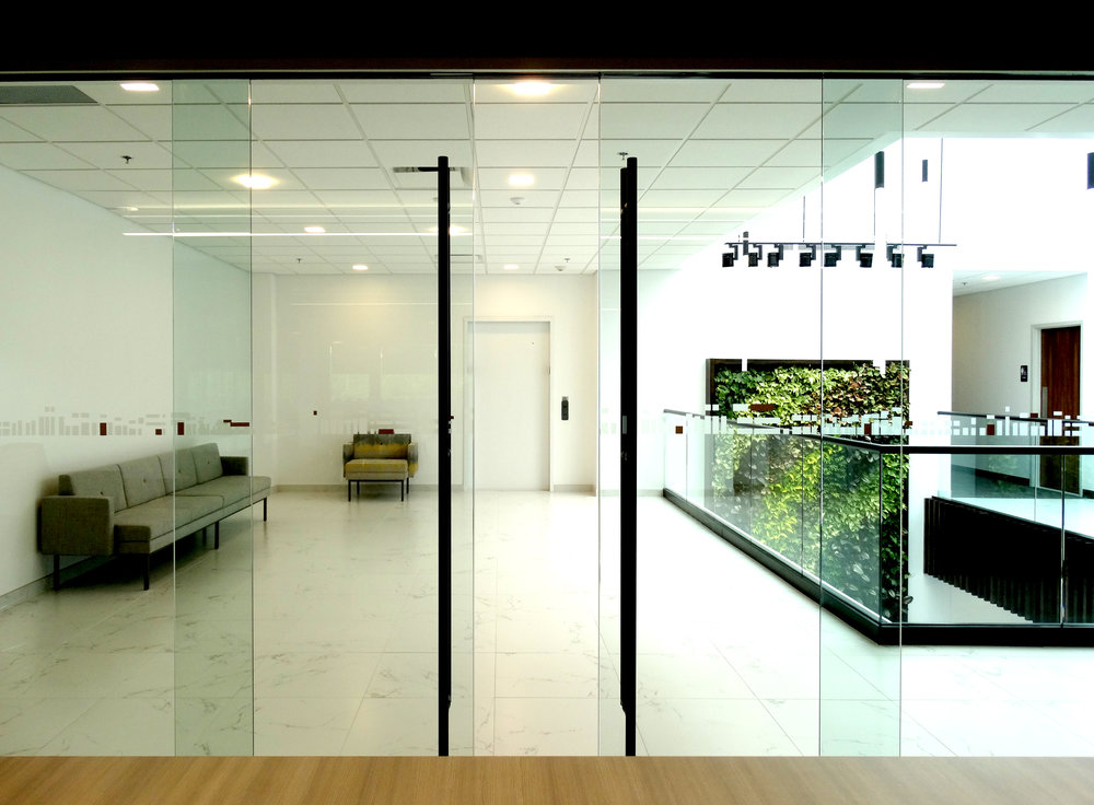 Illume Frameless Glass Synchronized Bi-Parting Sliding Doors - Spaceworks AI.jpg