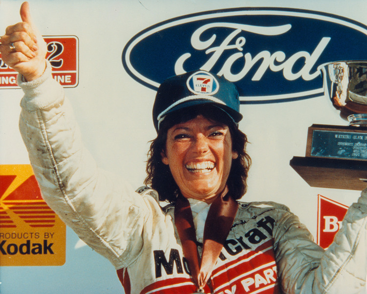Lyn St. James celebrates her win in the 1985 Serengeti Drivers New York 500 at Watkins Glen.