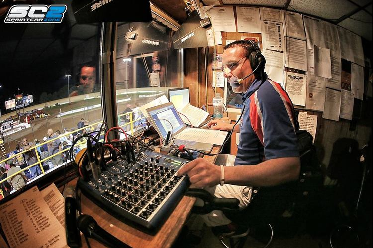 Johnny in the announcing booth at one of his many races he has worked over the years. photo provided