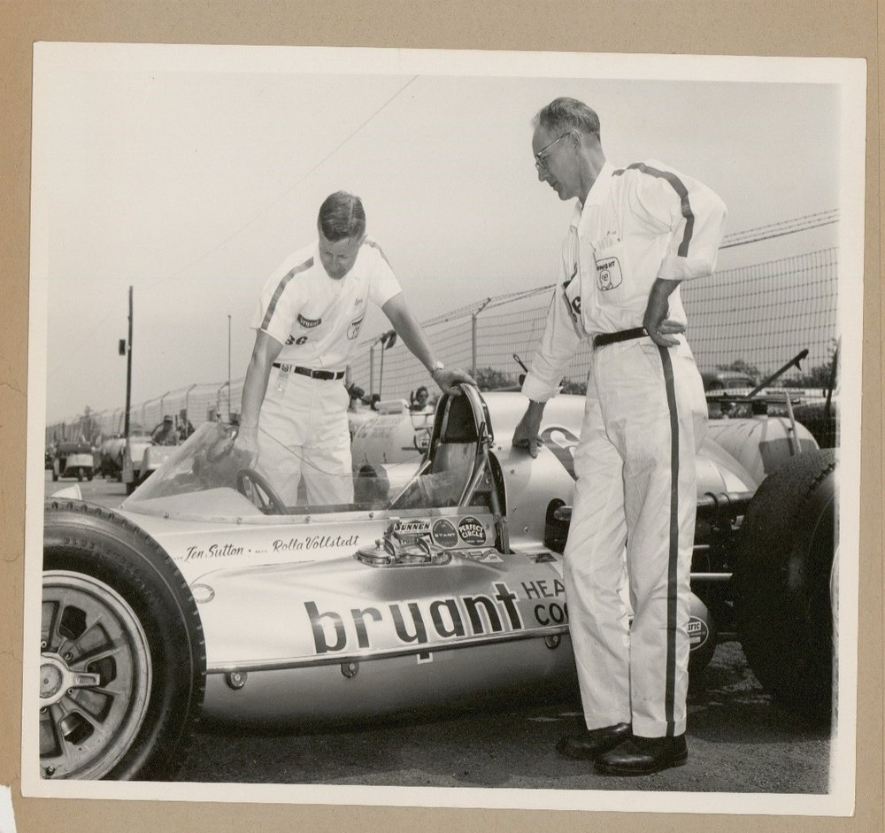 Len Sutton and Rolla Vollstedt with the No. 66 Bryant Heating and Cooling Special in 1964.  Vollstedt introduced one of the first rear engine cars to race at the Indianapolis 500 which also used torsion bars instead of coil springs and an Offenhauser engine.  The No. 66 would finish in 15th place.