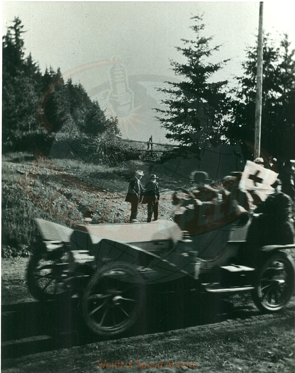 Back of photograph reads: First aid car at intersection of Bairdsdale and Division looking SW