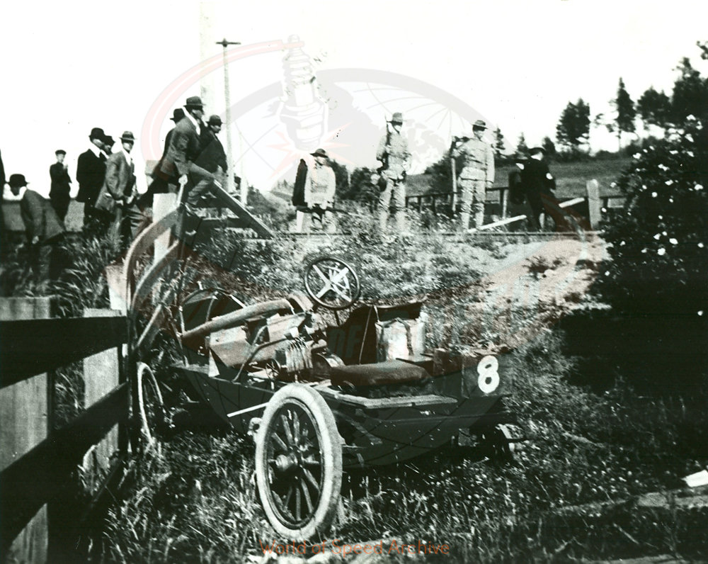 Back of photograph reads: Railroad crossing at foot of Vance hill on Division street looking East