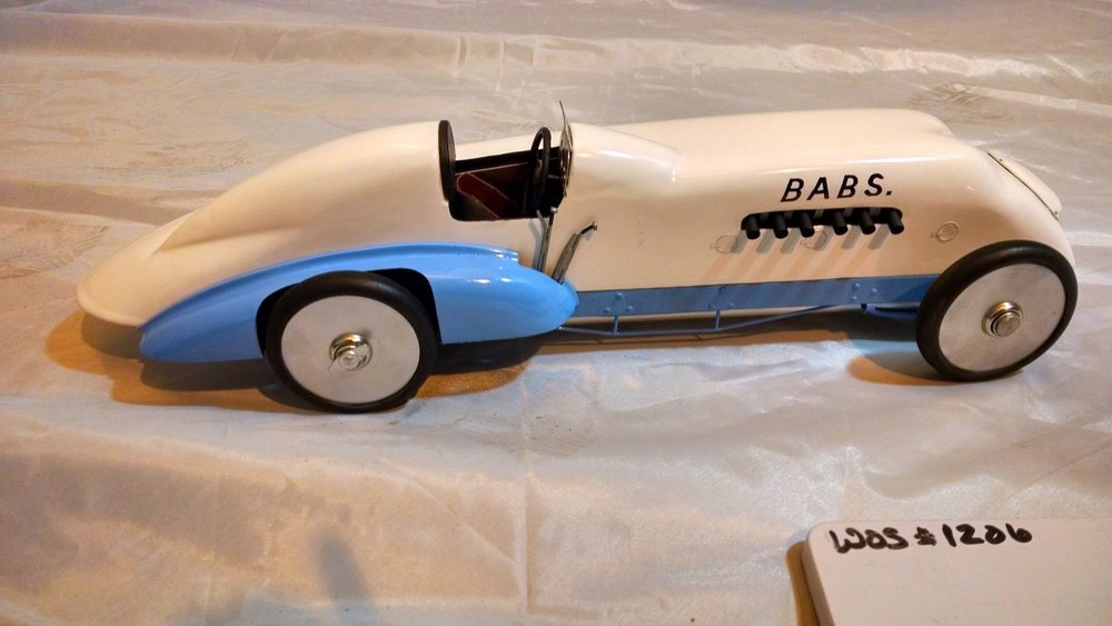 With a speed of 170.624 mph, John Godfrey Parry-Thomas set a world land speed record in 1926 with an earlier version of this car. Having lost the record to Malcolm Campbell in February 1927, Parry-Thomas attempted to regain it a month later at Pedine Sands in Wales but suffered a fatal crash.