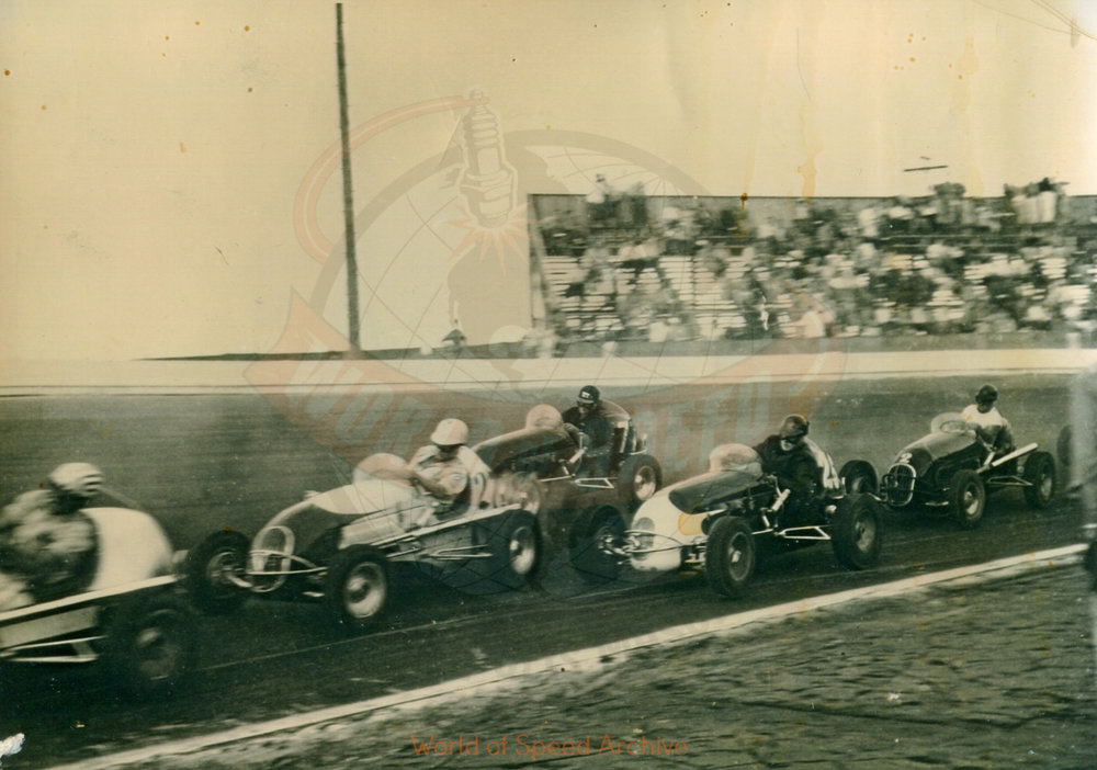Hildick Photo Collection WOS#5072, BH008  Received submission:  #27 is Wade Althuser, #25 is Bob Gregg, #77 is Louie Sherman, #2 is Gordy Livingston [in] 1948 and appears to be Jantzen Beach  [race track]