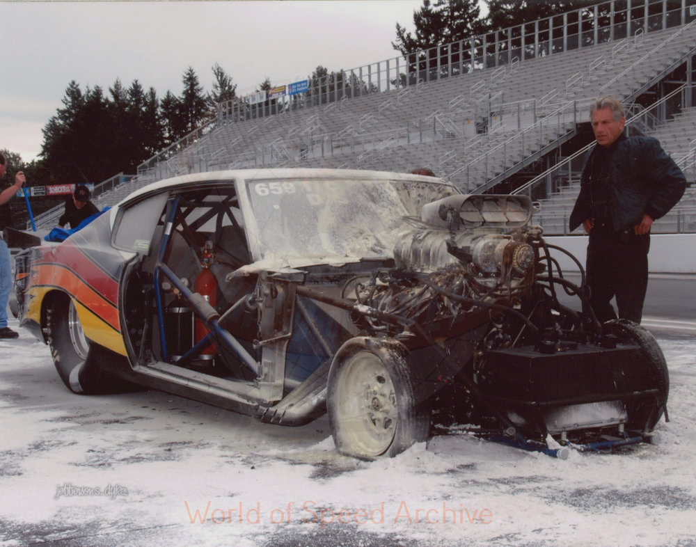 B4-S3-G2-F1-001 - dragster after engine fire put out; see also photo of car from the backend when in flames