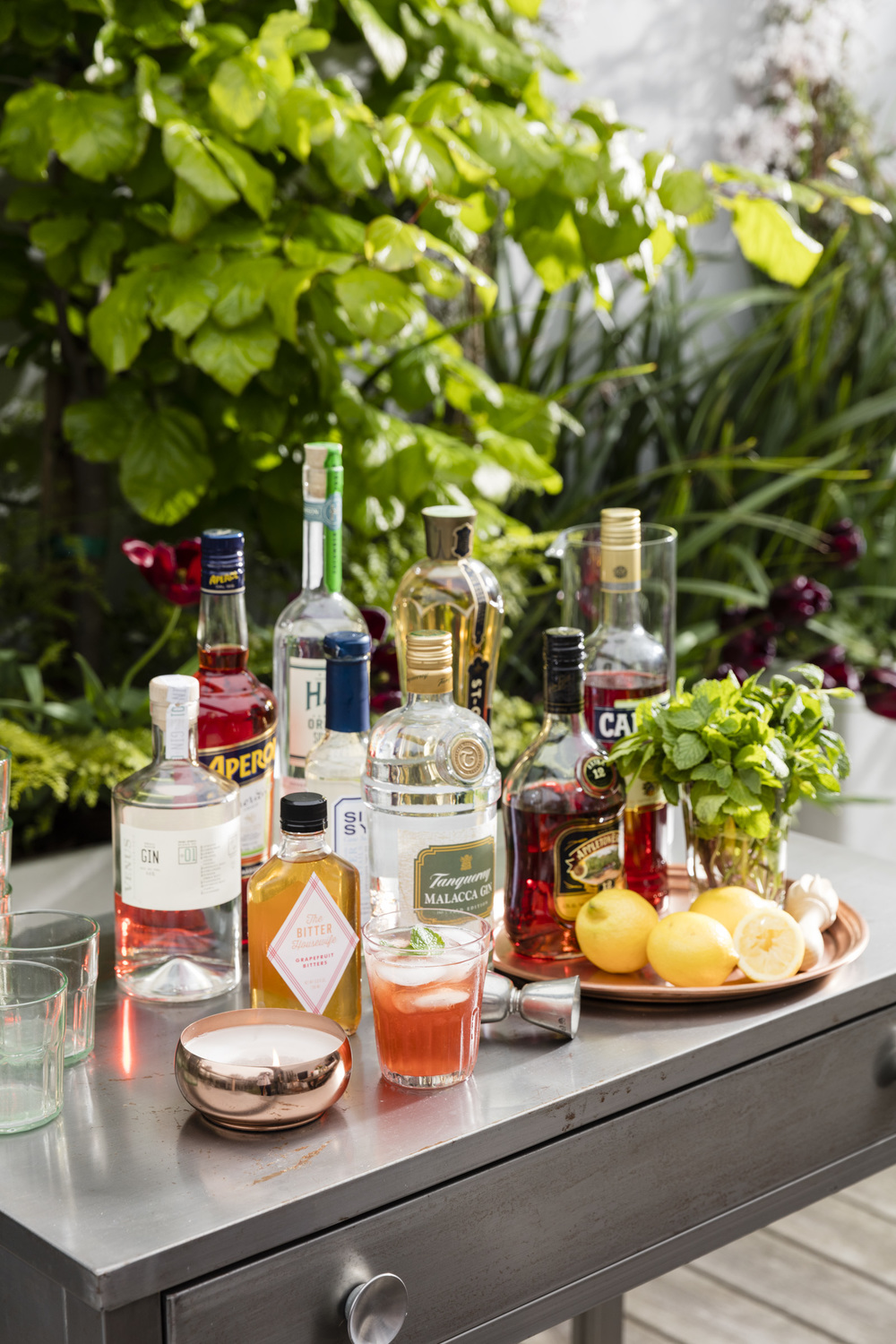 Cocktail Garden Whether it's a basil mojito, a Bloody Mary with fresh cherry tomatoes, or a Meyer lemon and sage drop, it's official: Cocktails have crossed into the culinary world. Our container garden highlights all of the botanicals that go into making great cocktails, from specialty citrus—the base for many of our favorite liqueurs—to all the goodies you need to mix, muddle, and embellish your beverage of choice.  Design: Homestead Design Collective Special Thanks To: Four Winds Growers, Sonoma Materials