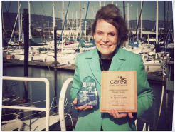12196272-dr-sylvia-earle-accepts-care2-impact-award-named-2013-wigf-trailblazer.png