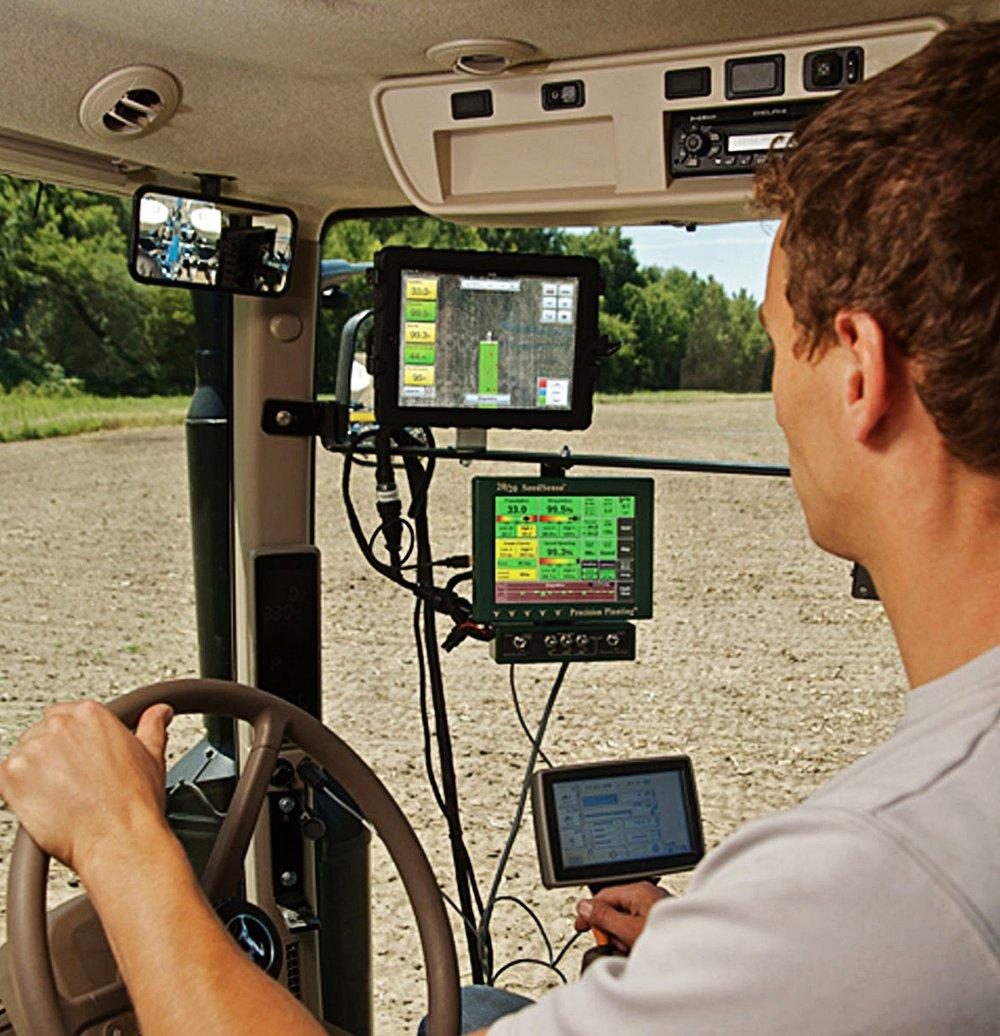 EQUIPMENT_Monitors_Farmer-in-Cab_LR.jpg