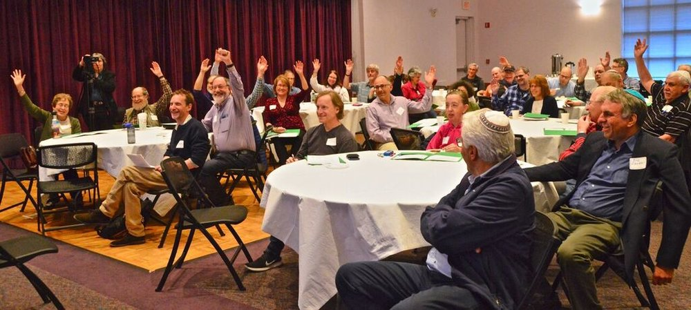 Solar for Synagogues hands up.jpg