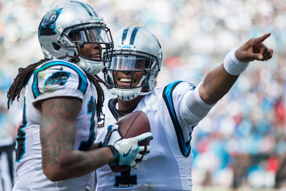 Cam celebrates with his star WR and encourages him to give the ball to a fan