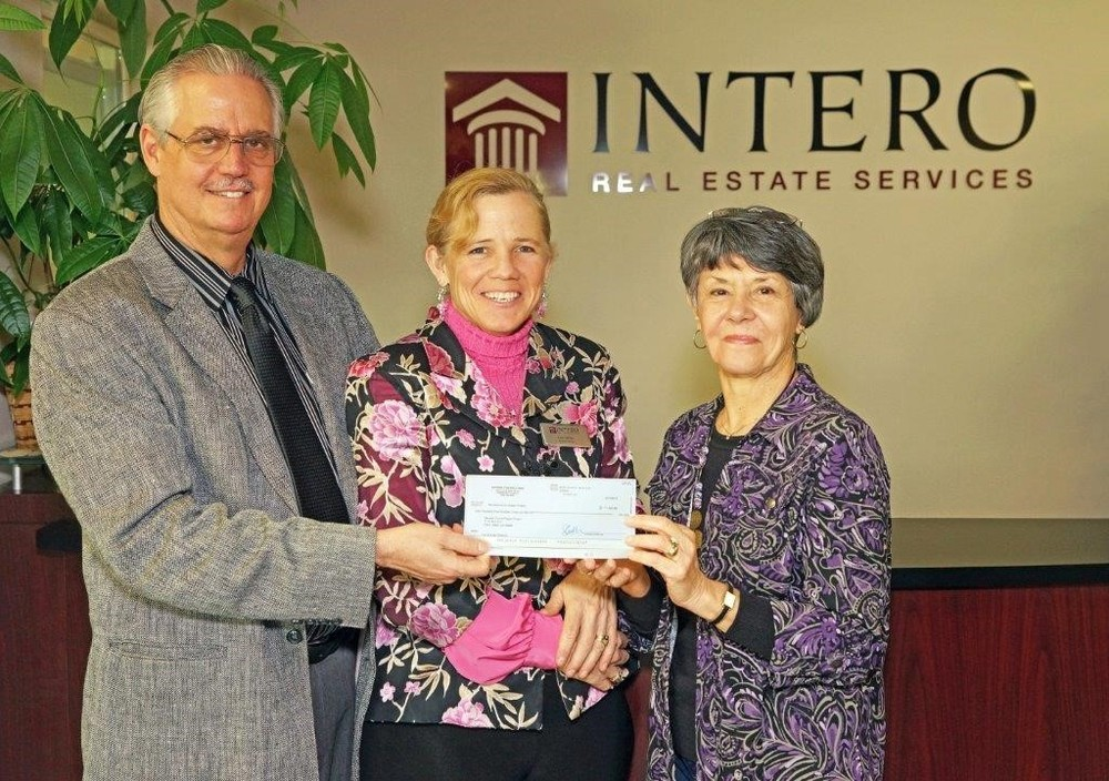 John and Edie Miller present check to Cathy Fagan of the Nevada County Diaper Project
