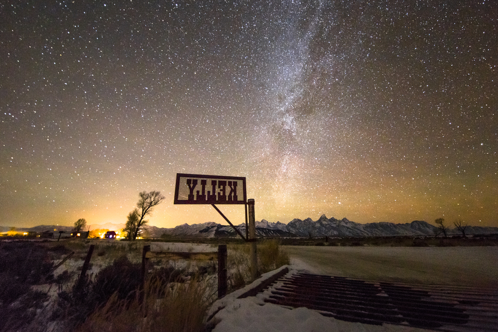 A night image of Kelly, Wyoming where the Milky Way is visible and the stars are fantastic
