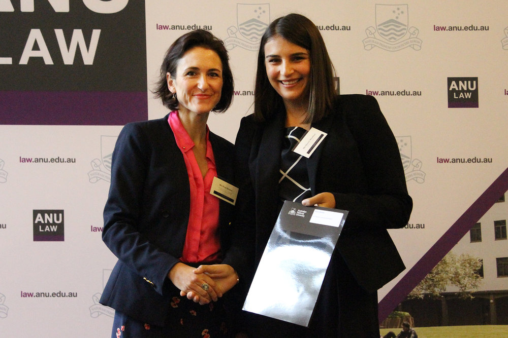 Naomi Wootton accepts ACT Women Lawyers Association Award from President Prude Bindon