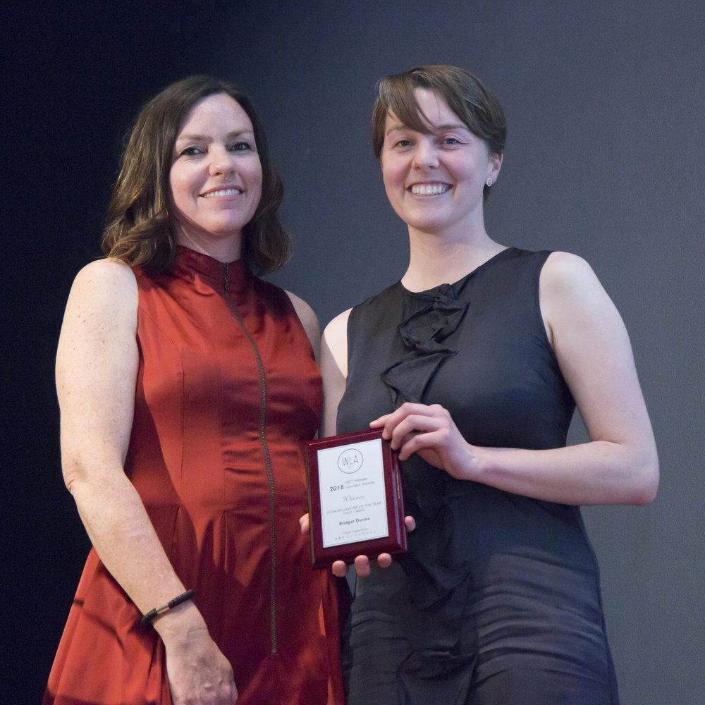 Bridget Dunne   receiving her award from from Deborah Battisson of College of Law, 2018 Awards Major Sponsor