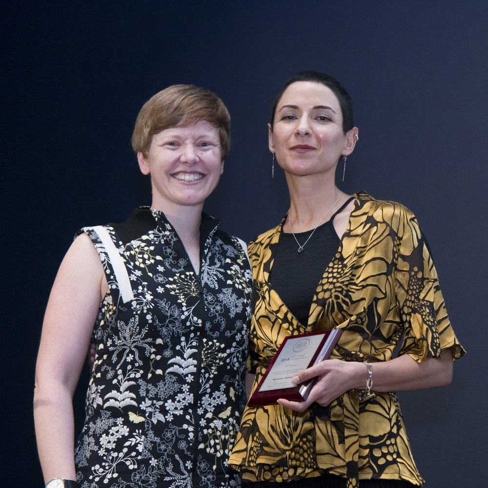 Parastou Hatami receiving her award from Heidi Yates, Victims of Crime Commissioner