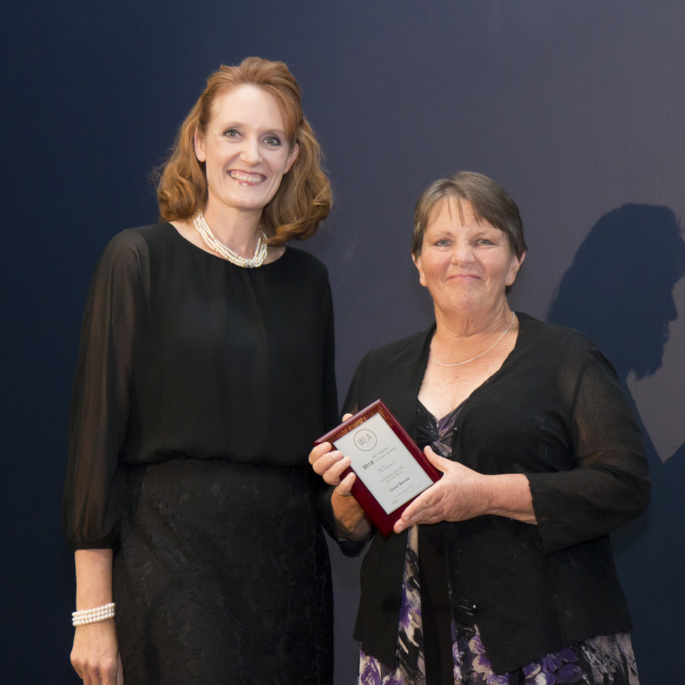 Carol Benda receiving her award from Katrina Musgrove of Key Chambers, 2018 Awards Premium Sponsor