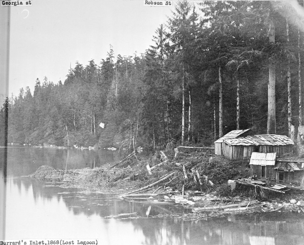 1868 - A Sḵwx̱wú7mesh dwelling, titled as the shore of Coal Harbour, but captioned as Lost Lagoon. Source: The City of Vancouver Archives Reference Code: AM54-S4-: St Pk N4 Item : St Pk N4 - [Squamish dwellings on the shore of Coal Harbour]