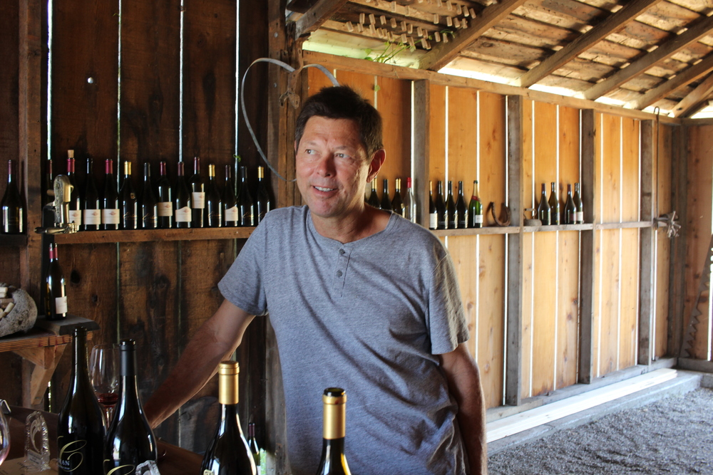 Bill Canihan pouring his wines in the barn in Sonoma.