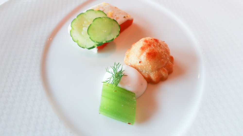 Smoked Trout Dumling, marinated Persian cucumbers and garden dill infused Creme Fraiche